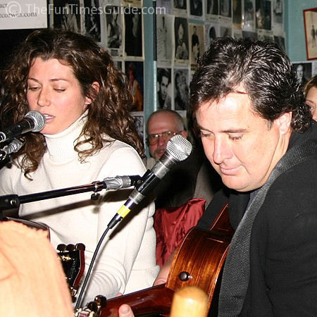 Amy singing while Vince accompanies her on guitar at the Bluebird.