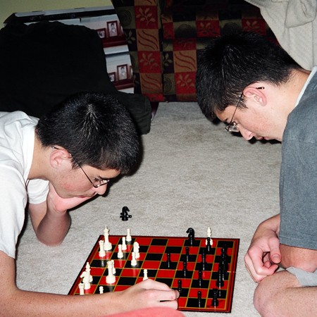Benjamin and James dualing at a game of Chess.
