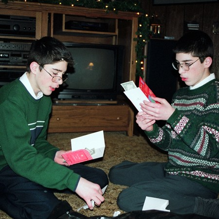 James and Benjamin opening Christmas gifts.