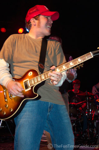 Brett Danaher playing the electric guitar in Pat Green's band.