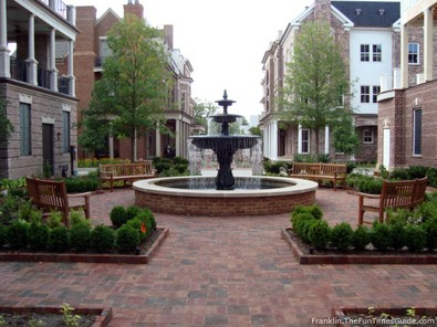 brownstone-courtyard-water-fountain-and-benches.jpg