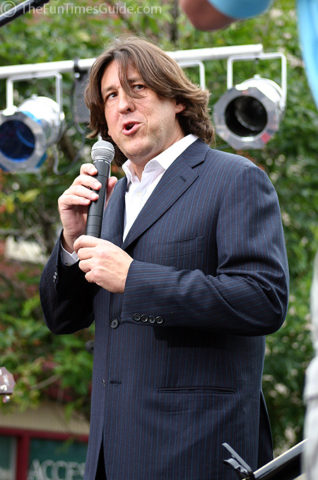 Cameron Crowe on stage announcing today's musical guests.