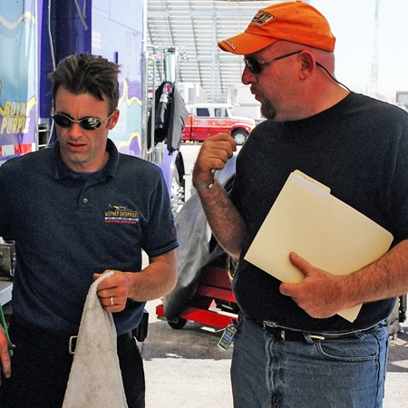 Jim chatting with Clay Millican about PitPass souvenir programs.