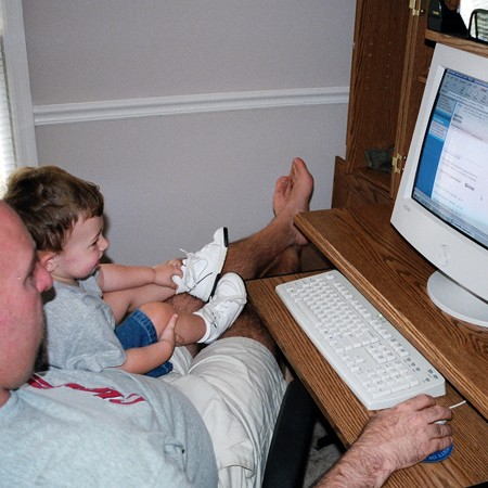Dylan playing on the computer with Uncle Jim.