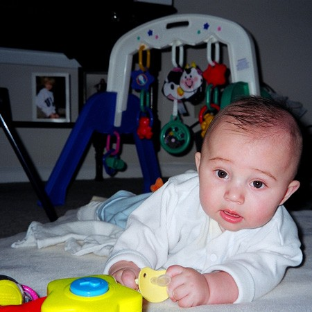 Little Dylan getting some tummy time during our visit.