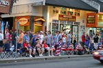 Fourth of July tourists lining the streets of Gatlinburg, Tennessee in anticipation of the midnight parade.