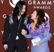 Jack White and Loretta Lynn accepting an award at the 2005 Grammy Awards. Photo copyright Gregg DeGuire.