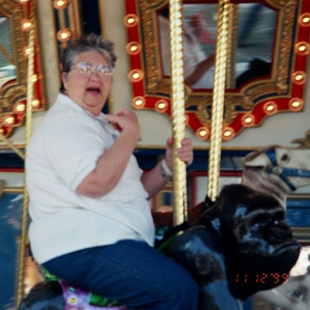 Long-time family friend, Jane, rides the merry-go-round at The ZOO.