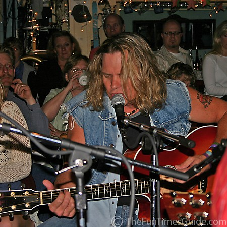 Jeffrey Steele playing his guitar at the Bluebird Cafe.