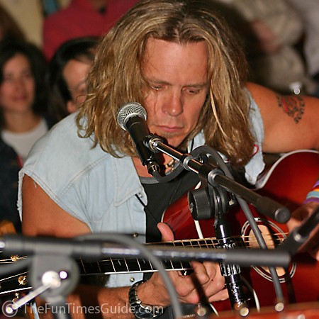 Jeffrey Steele playing guitar at the Bluebird Cafe in Nashville.
