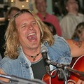 Jeffrey Steele singing and playing his guitar at the Bluebird Cafe in Nashville, Tennessee.
