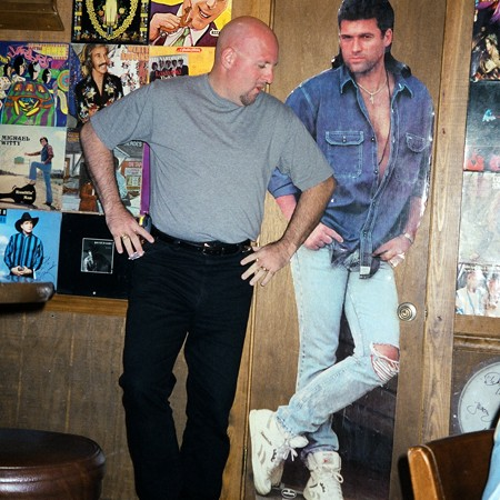 Jim standing next to a life-size poster of Billy Ray Cyrus.