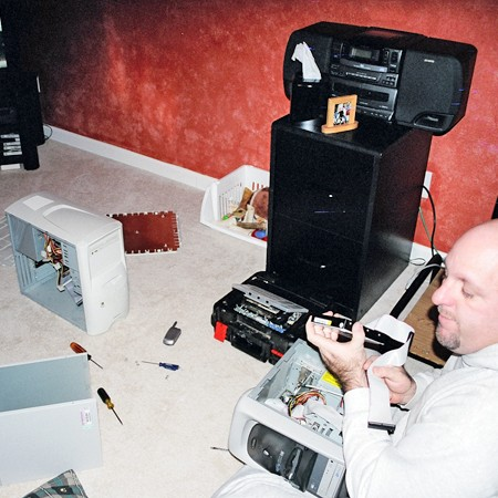 Jim fixing Lynnette's computer after she made it crash -- very late one night.