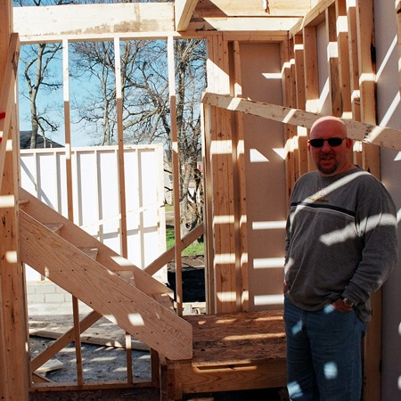 Jim checking out our newly framed house.