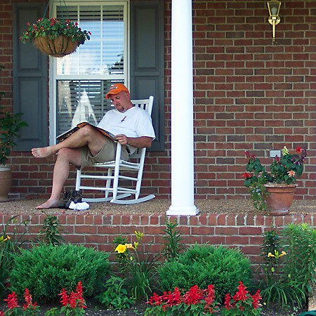 Jim reading the paper on the front porch.