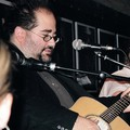 Jim Reilley and his guitar at the Bluebird Cafe in Nashville, Tennessee.