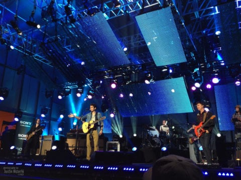 John Mayer performing with band on TV.