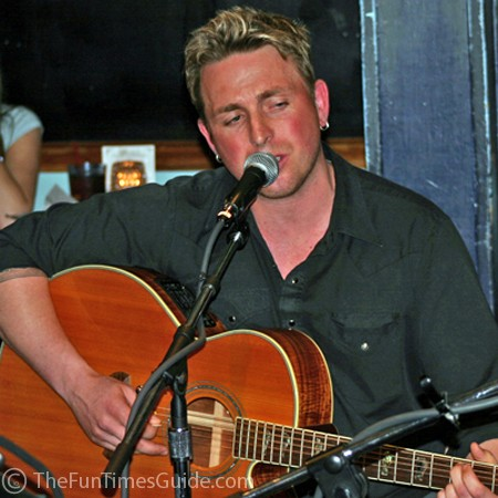 Johnny Reid singing a ballad at the Bluebird Cafe.