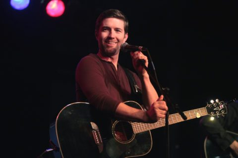 Josh Turner singing at the microphone