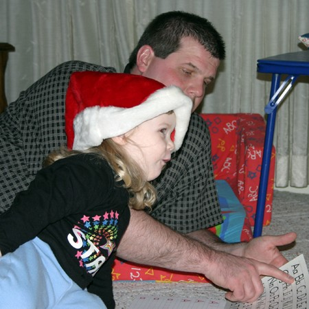 Karly is reciting the alphabet with Daddy.