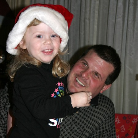 Karly and Daddy - having a good time opening Christmas gifts.