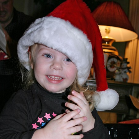 Karly wearing the traditional Santa hat to pass out presents.