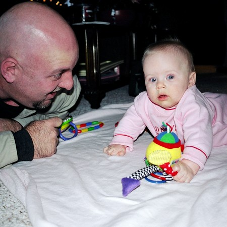 Uncle Jim playing with Karly and her toys.