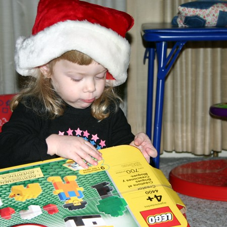 Karly opening our gift to her - Legos.