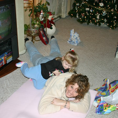 Karly tickling Aunt Lynnette after we opened all our gifts.