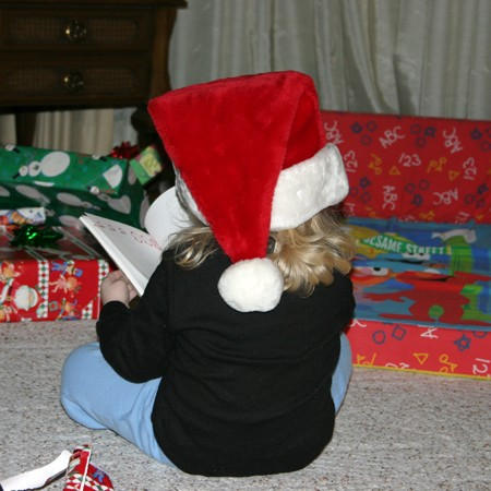 Karly reading the new 'electronic story book' she got for Christmas.