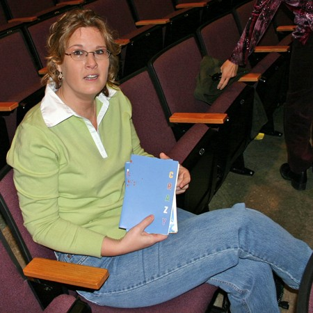 Lynnette seated up front at church -- holding a 'Crazy Campaign' brochure.