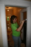 Lynnette painting the trim work.