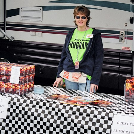 Lynnette selling PitPass programs at the racetrack.