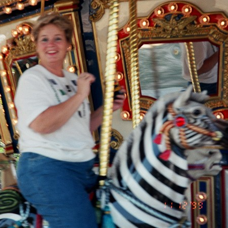 Kay on the merry-go-round at The Zoo.