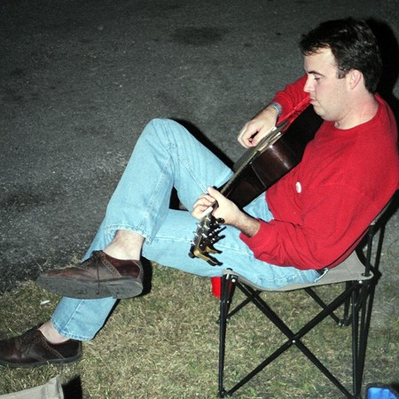 Mike playing the guitar after the races in San Antonio.