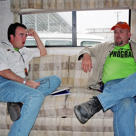 Mike and Jim talking business on the sofa inside the RV.