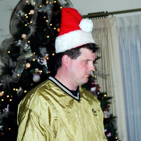 Lynnette's brother Mike playing Santa during the gift exchange.
