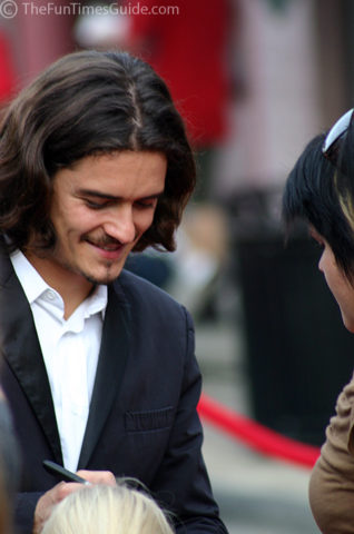 Orlando Bloom signing autographs for his fans.