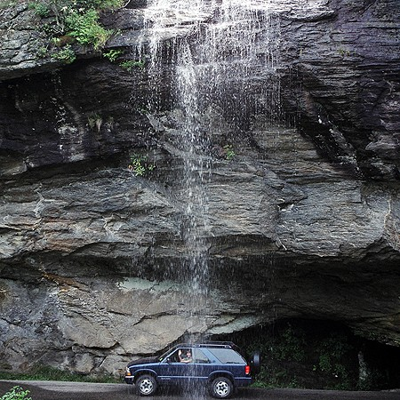 Suzie parked under a waterfall in Asheville, NC.