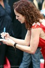 Patty Griffin signing autographs for her young fans at the premiere of 'Elizabethtown'.