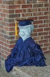 The Franklin Pig in cap & gown during graduation.