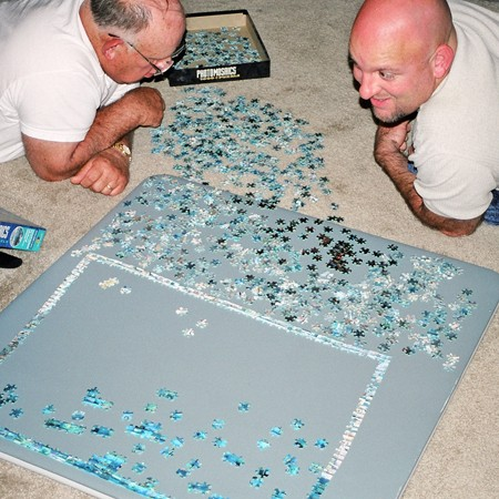 Jim and his dad contributing to the 'community puzzle' during their visit.