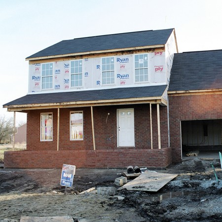 Photo of our house the day all the brick was applied to the exterior.