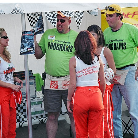Jim and Mike explaining the concept of PitPass magazine to the Hooters Girls.