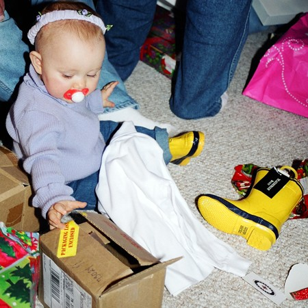 Shelby opening Christmas presents.