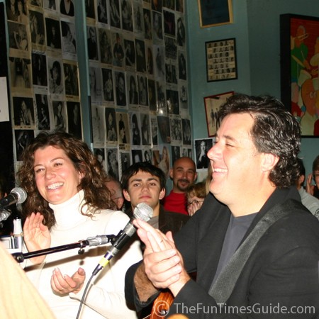 Vince Gill and Amy Grant laughing with the rest of us at one of Ashley Cleveland's 'bad' jokes.