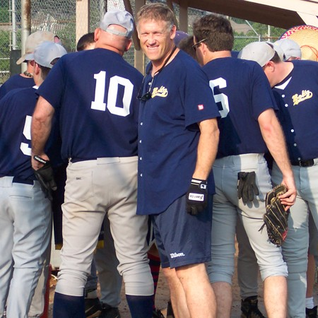 Jim's softball team forming a huddle prior to the game.