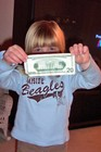 Sophie showing the $20 dollar bill she received from a passerby for a job well done.
