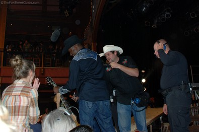 stagehands-trying-to-get-guitar-from-bobby-brown.jpg