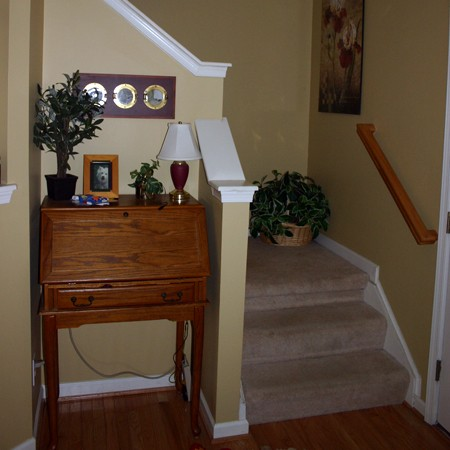 The foyer near the front door leading upstairs.